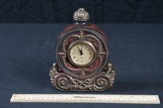 Decorative and Ornate  Quartz Desk Clock Made of Brass and Wood For more information visit us @ www.CalAuctions.com