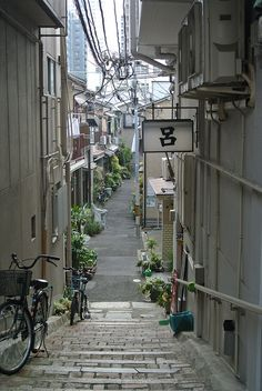 streets of Tanimachi Osaka city | Japan <-- love all the potted plants along streets and alleys in Japan.