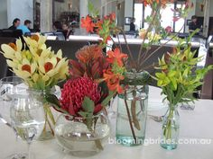 "beautiful Australian native flower table decorations but I am not a fan of the ""vases"""