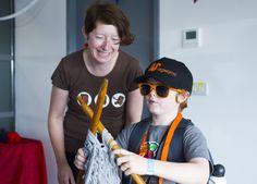 Mini Maker Faire visitor doing some giant knitting