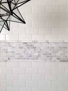 09 subway tiles accentuated with a tiny marble tiles border - DigsDigs