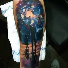 Enjoying The Cosmic View Tattoo On Arms For Male