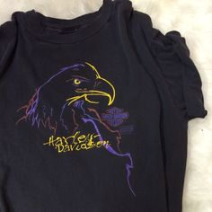 Vintage Harley Davidson Eagle Tee Awesome vintage tee! In great shape! Here are the measurements if you're interested! Measurements (laying flat) Shoulder to shoulder: 22 inches Chest: 23.5 inches Length: 28.5 inches Sleeve length: 8 inches Vintage Tops Tees - Short Sleeve
