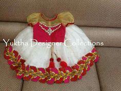 https://m.facebook.com/YukthaDesignerStudio White lehenga with stunning border with pink blouse