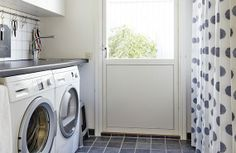 Laundry room, love the hook rack above the sink