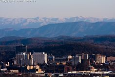 Knoxville, TN with snow-covered Smoky Mountains in the background.