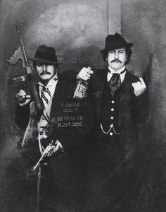THE MAFIA | Pablo Escobar (right) posing as a gangster with...