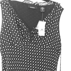 Express blouse  Black & white dotted Express blouse.  Size 8 Never worn with tags still on.  Shell is 100% silk with %100 polyester lining.  Super adorable shirt that would look great alone or under jacket. Quick shipping! Happy Poshing ❤️ Express Tops Blouses