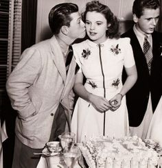 Judy Garland's 18th birthday celebration with fellow MGM juvenile stars Mickey Rooney and Jackie Cooper, June 10, 1940.