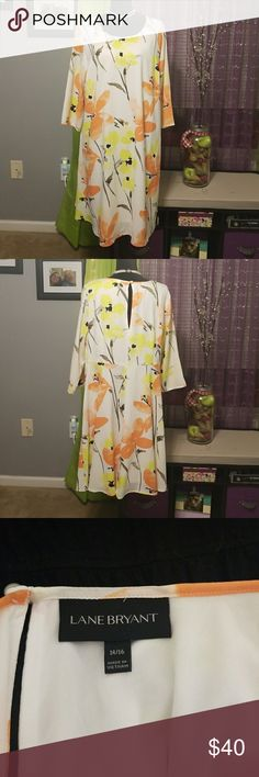 Lane Bryant Dress Love, love, love this dress! Beautiful white dress, with all over large flower pattern. Pullover, with keyhole back, peatl button closure. Very cool light material. Fully lined. 3/4 length sleeves. Choker not included, but is for sale in mt closet. Lane Bryant Dresses Midi
