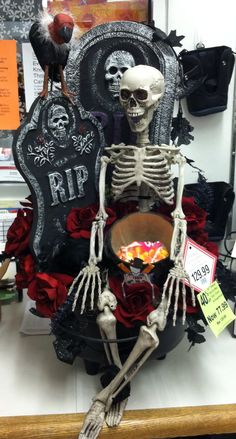 Halloween arrangement, the skeleton is holding a  pumpkin that can be filled with candy for trick or treating