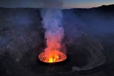 The permanent lava lake of the Nyiragongo Crater is the biggest in the world with an estimated 282 million cubic feet of lava. The volcano's rim lies 11,380 feet above the ground. At 1,300 feet deep, the lava lake has created one of the many wonders of the African continent.