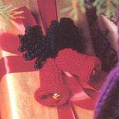 Ornamental Bells | AllFreeKnitting.com his easy knitted gift will add a certain jingle to your holiday presents. These Ornamental Bells will spread Christmas cheer no matter how you use them!