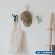 For hooks that add a lot of character to your room, look no further than our Buddy Hooks by Umbra! These hook buddies seem to climb right up the wall to help you hang hats, coats, jackets and more! Hang Hats, Lego Wall, Reach In Closet, Hat Hooks, Entryway Organization, Lego Toys, Container Store, Pastel, House Design