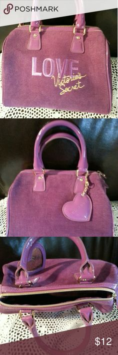 LOVE Victoria's Secret tote Purple/Pink Pre-loved tote. Fuzzy soft material on the outside with satin type lining. Clean with no marks, tears, or stains. Outside bottom has some scratches and scuffs, but the handles are in great condition. Cute heart mirror embellishment hands from handle. Medium/Small handbag that holds the essentials. 9x4.5x7 Victoria's Secret Bags Totes