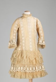A little girls lace party dress, circa 1885.
