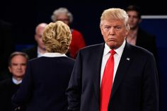 Democratic presidential nominee Hillary Clinton and Republican presidential nominee Donald Trump listen to a question during the town hall debate at Washington University on Oct 9, 2016 in St Louis, Mo. (Photo by Saul Loeb/Pool/Getty)