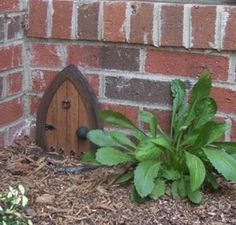Wooden gnome door. I want too put one in the garden area..
