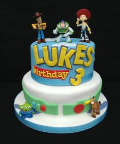 Toy+Story+cake+-+Happy+Birthday+Luke!!    +A+two+tier+Toy+story+cake+for+a+special+little+boy!    +The+bottom+tier+is+vanilla+madeira+with+buttercream+and+jam+filling+and+the+top+tier+is+a+chocolate+cake+with+chocolate+buttercream+filling+covered+in+fondant+icing.+The+letters+and+letter+background+are+hand+cut.  +  +The+cake+has+little+toy+figures+for+the+birthday+boy+to+keep!    +I+loved+making+this+cake!!