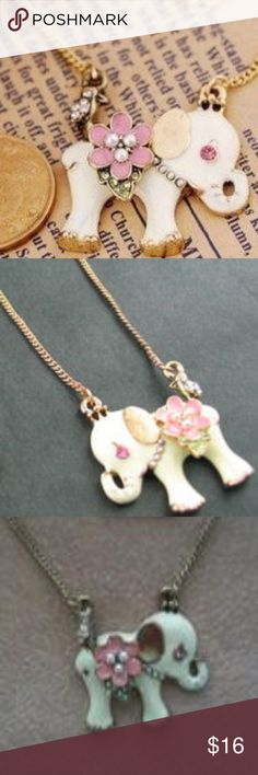 "White Elephant Necklace This is a long necklace for a Woman or Child. It measures 28"" long. It is a nice gold plated chain necklace with a white elephant attached to it as the focal point.  The elephant measures 1.25"" across. It has a pink daisy like flower with three little white ""pearls"" in the center and a very shiny green, rhinestone stem where the saddle would be on an elephant if they had one. They have pink rhinestone eyes. ""pearls"" around the neck of the elephant and a gold ear…"