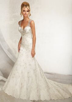 """Elegant emboidered V-Neck Mermaid bridal dress. Two colors available: White and Ivory. Sizes: 2-28. Three lengths: 55"""", 58"""" and 61"""". Designed by Madeline Gardner."""