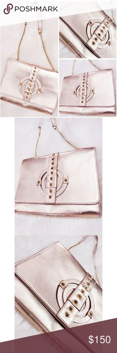 """VINCE CAMUTO Metallic Rose Gold Stud  Chain Purse Excellent condition!  No signs of wear! Stunning purse,  metallic pink/rose gold color,  gold metal hardware, gold chain strap, gold studs.  Super chic, shiny, Millennial pink! Dark gray logo interior.  Fold over snap closure.  Wear as shoulder bag or clutch. Perfect for holidays, parties, night out.  Approximate measurements: -Height- 7.5"""" -Width- 9.5"""" -Depth- 1.5"""" (laying flat, can expand) -Strap Drop- 12"""" 2 inside zipper pockets, 2 open…"""