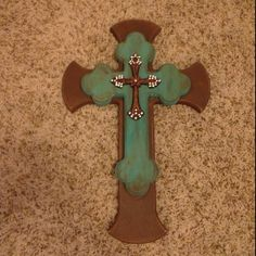 Painted & sanded crosses, then glued together & held together by clamps. :) #artprojects #decoration