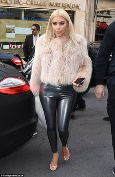 Is she fur real: The star donned a peach fur coat, which she teamed with a white fur scarf