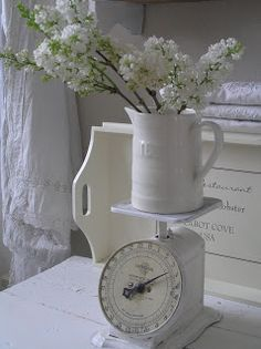 love the vintage scale with the white pitcher and white flowers