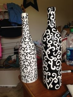 Design wine bottles...would be cute to add bright flowers!