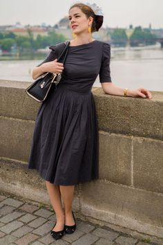 RetroCat wearing a 50s inspired retro dress and vintage accessories while visiting Prague.