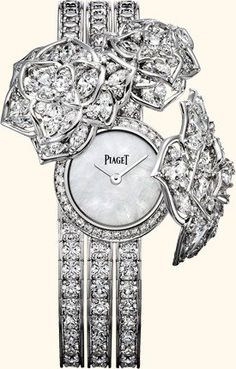#PiagetRose - secret watch, 21 mm. Case in 18K white gold set with 177 brilliant-cut diamonds (approx. 1.9 ct) and 53 marquise-cut diamonds (approx. 6.5 cts). White mother-of-pearl dial. Bracelet set with 153 brilliant-cut diamonds (approx. 18.4 cts). Piaget 56P quartz movement.