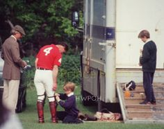 """Cute Little Prince Harry helping his """"Papa"""" Prince Charles in wearing Shoes..before a Polo Match..!and Prince William i..."""