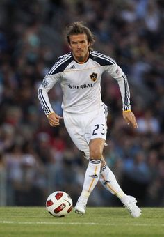 David Beckham of the Galaxy runs the ball during the friendly match between the Newcastle Jets and the LA Galaxy at Energy Australia Stadium on 27 Nov 2010
