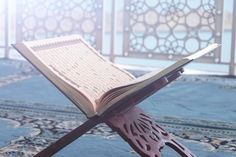 Qur'an is a holy book of muslims close-u...   Premium Photo #Freepik #photo #books #wood #islamic #education Coffee Time Quotes, Construction Wallpaper, Free Couch, Quran Wallpaper, Ramadan Lantern, Islamic New Year, Muslim Men, Book Stands, Purple Backgrounds