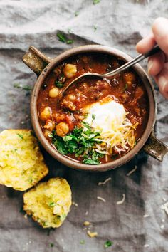 Spicy Posole with Cheesy Jalapeño Cornbread Muffins - One of my favorites for meal prep lunching. Posole plus some cornbread? YUM. | pinchofyum.com
