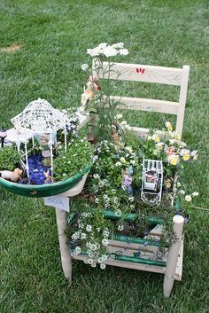 Chair garden...I have several old chairs that would look really cool all decked out like this...