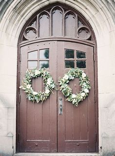 Hang wreaths to your ceremony venue's doors for a festive look | Brides.com
