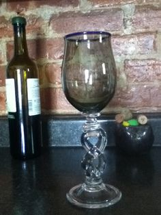 Hey, I found this really awesome Etsy listing at http://www.etsy.com/listing/159257672/gray-wine-glass-with-blue-lip-and