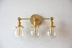"""Free Shipping! Vanity Light Three Globe Clear Gold Brass Wall Sconce 6"""" Mid Century Industrial Modern Art Light UL Listed by IlluminateVintage on Etsy https://www.etsy.com/listing/472889158/free-shipping-vanity-light-three-globe"""