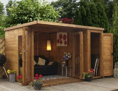Amazingly cute outdoor relaxing garden room with sofa and expansive opening doors