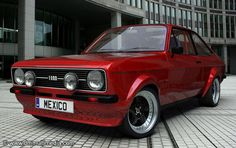 Mk2 Ford Escort. What a great paint colour... And I don't really like red cars!
