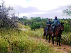 Corporal Simon Nyawo and Ze head out on a horse patrol in the Park