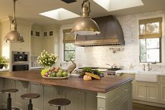love the feel of this kitchen but would have to hang chandeliers instead of this lighting..
