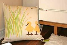 The yellow ducky pillow that was the perfect inspiration piece for my baby's tranquil modern nursery design. I knew that the Amenity Eco baby bedding set was the perfect inspiration piece for tranquil, modern nursery ideas when I found it online.  I had been looking