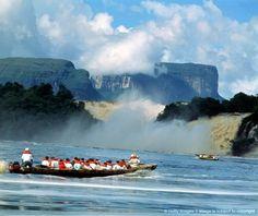 Venezuela, Canaima Nat. Park, Rio Carrao, tourists in dugout canoe