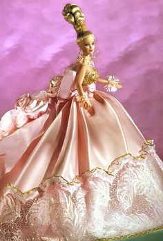 "Pink Splendor, designer not recorded.  This was more of the typical ""pink box"" Barbie in one sense, except for the size of the skirt's train -- a real execution of this would have a train of maybe 4-5 feet on the gown!"