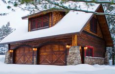 Craftsman - Series Arched Wood Garage Doors. Mossy Oak style, Log and Stone! I love this garage!