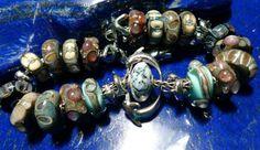 Trollbeads bracelet featuring beads designed by Scott bouwens