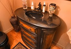 Oval cabinet sink in bathroom in renovated former carriage house.